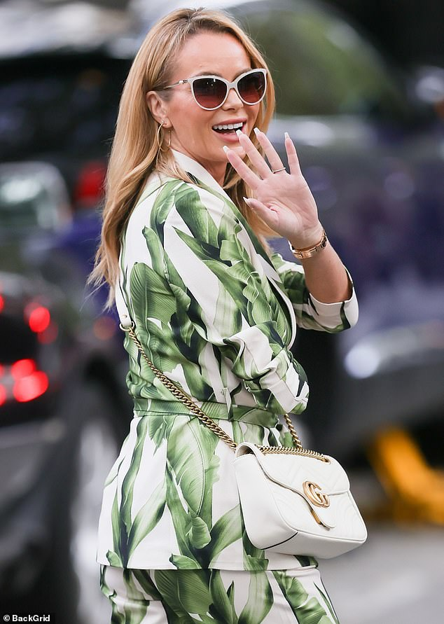 Amanda Holden, 50, puts on a stylish display in palm leaf printed suit alongside Ashley Roberts, 40