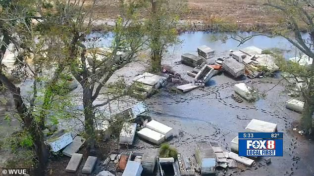 Caskets still scattered around Louisiana town weeks after being washed out of tombs by Hurricane Ida